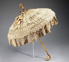 """omgthatdress: """" Parasol ca. via The Costume Institute of The Metropolitan Museum of Art """"Parasols were for show, carried as an accessory to complete a toilette. This example is fitted with a crook at top so it could be carried with the. 1880s Fashion, Victorian Fashion, Vintage Fashion, Vintage Outfits, Vintage Dresses, Antique Clothing, Historical Clothing, Antique Lace, Vintage Lace"""