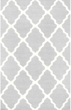 A contemporary rug that blends the traditional comfort and beauty of a hand hooked wool rug with a modern design, the Rugs USA Homespun Moroccan Trellis Rug is a luxurious addition to any home. Bold, wavy lines extend back and forth across the rug, creating an ordered diamond geometric motif. This Moroccan fashion-forward design lends both warmth and ethnicity to a room. This rug is available in Light Grey, Sunshine, Bubble Gum, Tan, Turquoise, Beige, Lime, Brown, Emerald, Berry, Blue, Navy…