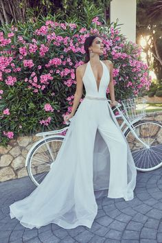 Wedding jumpsuits Wedding trousers and jumpsuits for the fashion-forward bride weddingjumpsuit wedd Wedding Pantsuit, Wedding Attire, Wedding Trouser Suits, Wedding Suits For Bride, Pant Suits, Wedding Outfits, Ronald Joyce Wedding Dresses, Bridal Gowns, Wedding Gowns