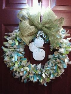 Sand Dollar Beach Decor Wreath I Made! About 180+ feet of ribbon and 1/2 yard of sand color fabric (not all used) with real sand dollars and added bow I made.