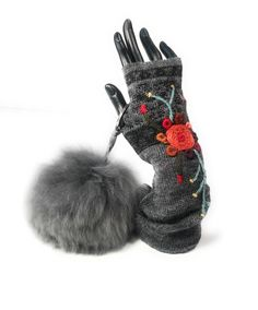 Not just any texting gloves.  Handmade out of baby Alpaca with unique hand stitching.  Shown with the softest 100% real baby Alpaca fur pom pom.    www.PeruvianAccent.com