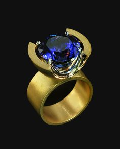 Gold/Platinum Oval Tanzanite Ring Modern Classic: Gold/Platinum Oval Tanzanite Ring Designer: Gordon Aatlo/Gordon Aatlo Designs