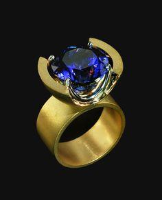 Gold/Platinum Oval Tanzanite Ring Modern Classic: Gold/Platinum Oval Tanzanite Ring Designer: Gordon Aatlo/Gordon Aatlo Designs
