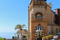 This place is heaven on earth, you have to go there!!!!!  Hotel Villa Carlotta Review | Taormina – Sicily Taormina Sicily, Heaven On Earth, Luxury Travel, Big Ben, To Go, Villa, Around The Worlds, Building, Places