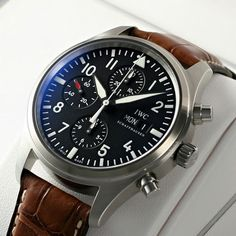 IWC- really liking the look of a black faced watch with a brown strap