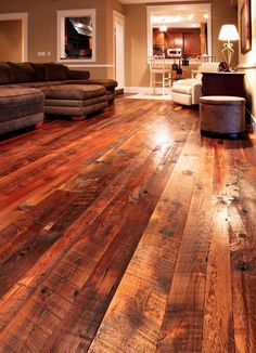 barn wood flooring. never have to worry about kids or dogs scratching the wood floor.