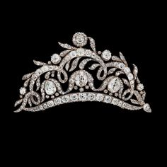 An old cut diamond tiara, circa 1850s.   Later brooch fitting added in gold to the tiara stand fitting. (via Bukowski's)