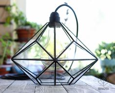 Exclusive StereometricDesign's chandelier with Edison's retro bulb.  In geometry, a triakis octahedron is an Archimedean dual solid, or a Catalan solid. Its dual is the truncated cube.  #stereometricdesign #glasslamp #retrolamp #minimalistic #diy #handcraft #homedecor #interior #geometry #octahedron #triakis #bulb #retro #glasswork #chandelier #kaluga #interiorlight #tiffany #art #retrolamp