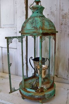 Inspiration for Chalk Paint® Patina.  Large tall display showcase or lantern metal glass ornate observation box home decor Anita Spero