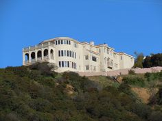 abandoned mansion that sits atop the hill overlooking L.A.   There must be an interesting story here.