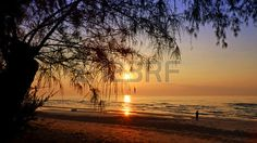 Picture of Sunrise at Wanakorn Beach National Park, Prachuap Khiri Khan Province, Thailand. stock photo, images and stock photography. Sunrise, Thailand, National Parks, Stock Photos, Celestial, Beach, Water, Image, Photography