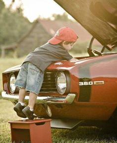 Pretty sure this was my husband at that age. He drove his Dad's milk truck when he was 5. He's a serious motor head.