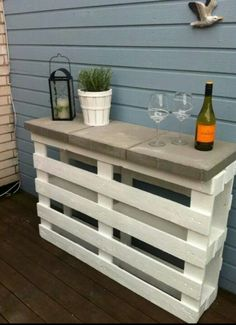A couple pallets and some bricks and you have an outside bar
