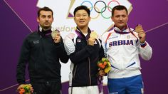 Korea first golden medallist.  http://media.jtbc.co.kr/2012London    Medallists pose after men's 10m Air Pistol Shooting final    (L-R) Silver medallist Luca Tesconi of Italy, gold medallist Jongoh Jin of Korea and bronze medallist Andrija Zlatic of Serbia pose on the podium during the Victory Ceremony for the men's 10m Air Pistol Shooting final on Day 1 of the London 2012 Olympic Games at The Royal Artillery Barracks on 28 July.