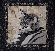 The Calico Cat: A couple cat quilts from the show...