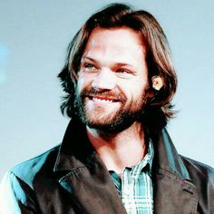 Image may contain: 1 person, smiling, beard and closeup