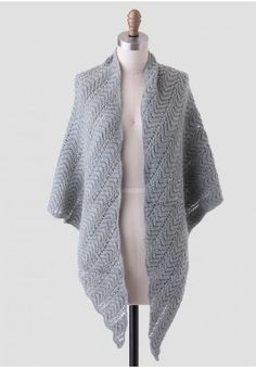 This cozy, dusty teal-hued shawl features a zigzag knit pattern and braided detailing throughout. Perfect for wearing as a scarf as well!