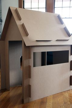 What a great DIY cardboard playhouse!