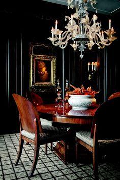 Stunning black dining room.