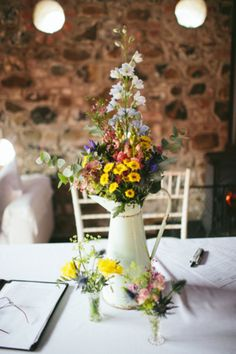 A Backless And Sophisticated Sarah Janks Dress For A Colourful Barn Wedding
