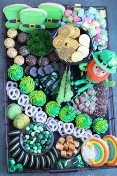 """Treat your Leprechauns to a festive and fun St. Patrick's Sweets Charcuterie! Let's start with a """"pot of gold"""" filled with chocolate coins, leprechaun humor, a hint of rainbow goodness and lots of green candy and homemade bakery treats! St Patrick Day Snacks, St Patricks Day Food, Saint Patricks, Charcuterie Recipes, Charcuterie And Cheese Board, Holiday Treats, Holiday Fun, Antipasto, Party Food Platters"""
