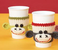 Brighten up your morning coffee with a grinning sock monkey cup cozy! This cozy that stretch to fit the cup, making this a great little gift for your favorite coffee fan. Shown in Patons Classic Wool. (Patons Yarns)