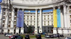In Kyiv. Banners fly of Ukraine and the European Union.