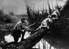 Three German sharpshooters climb a tree at the Aisne River in northern France during the First World War. The soldiers plan to pick off French soldiers near the front line.