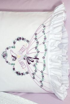 These pillowcases are a beautiful show of skill and needlework. Description from shop.com. I searched for this on bing.com/images
