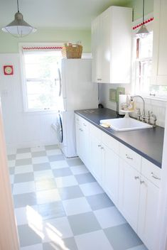 This pic by Megan Ford shows a painted vinyl floor! How tos, and more kitchen decorating ideas here...