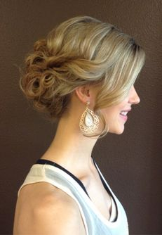 Hiding your hair ties and bobby pins make for a natural and romantic look.