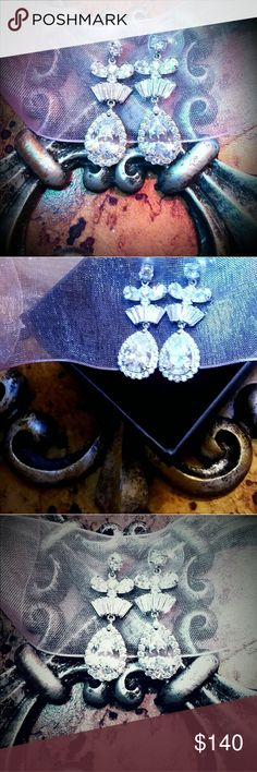 🎀 9CTTW AAAA TOP PREMIUM CZ CHANDELIER EARRINGS🎀 THE MOST ELEGANT CHANDELIER 9CTTW PREMIUM AAAA QUALITY 100 FACET EARRING w/LG 4CT PEAR DROPS ADORNED w/SPARKLING HALO OF ROUND PAVE' STONES & PRISTINE BAGUETTES LIKE A FAN ABOVE THE LG PEARS & LASTLY, THESE MIND-BLOWING FLOWING ALL 100 FACETED AAAA CZ's THROUGHOUT ALL 9CT's FINISHING WHERE THESE BEAUTIES BEGIN ON YOUR EAR w/A SIMPLE DIAMOND- LIKE  .50 CT ROUND THEN, THESE PIECES OF ART MOVE ON DOWN & LEAVES EVERYONE SPEECHLESS......AHH…