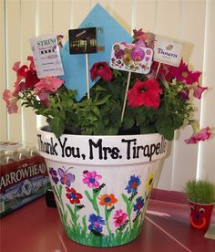 Teacher Appreciation Gift - Student's fingerprints as flower petals on painted terracotta pot, filled with petunias & gift cards.