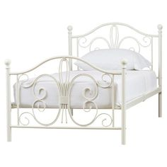 Showcasing elegant scrollwork details on the headboard and footrest, this lovely metal bed makes a feminine-chic foundation