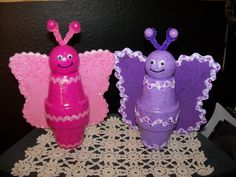 Butterflies made with clay pots, wood ball, craft foam, paint and decorations to your liking.