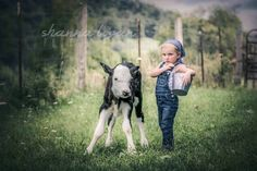Little girl and calf. Take it without the sass lol