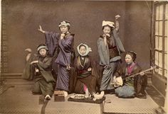 A group of female performers (The woman on the right is holding a Shamisen, while the other women strike poses) - Japan 1909 - Wolcott, Katherine taken from: University of Vermont, Bailey/Howe Library, Special Collections February 01, 2011,