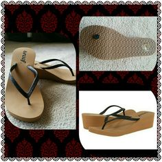 **PARTY SALE**NWOT Reef flip flops Never worn size 7 Reef flip flops. Tan and black with the versatility of wearing them with any outfit . reef Shoes