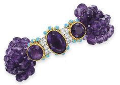 A DIAMOND, AMETHYST AND TURQUOISE BRACELET, BY CARTIER  The clasp set with three bezel-set amethysts, enhanced by circular-cut diamond and cabochon turquoise detail, to the eight-strand amethyst bead bracelet, mounted in platinum and 18k gold, 8½ ins., with French assay marks and maker's mark