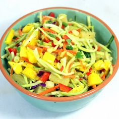 I think I have a new favorite Cole Slaw (Actually in this case, Broccoli Slaw). Fresh sweet Mango, Pineapple juices and tidbits combine. Potluck Dishes, Potluck Recipes, Side Dish Recipes, Summer Recipes, Real Food Recipes, Salad Recipes, Cooking Recipes, Yummy Food, Vegetable Salad