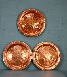 3 x Copper Chargers https://www.walcotandco.co.uk/metalware/3-x-copper-chargers