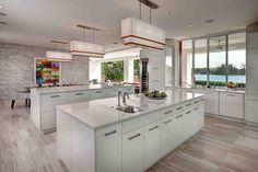 Modern Kitchen with Ultracraft Destiny Slab Cabinets, Flush, sandstone tile floors, Pendant light, U-shaped, Undermount sink