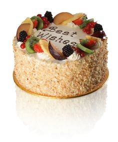 Macedonia Cake with Nibbed Almonds - Vanilla Sponge layered with fresh cream and fresh fruits decorated with glazed exotic fruits. Finished with roasted nibbed almonds