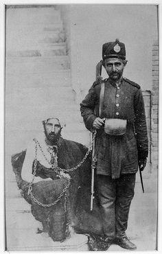 Iran / Persia, a guard with his prisoner