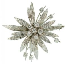 A DIAMOND SIX FLOWER BROOCH IN TEXTURED WHITE OLD, MARKED 750, 9.6G  Sold @ Mellors & Kirk