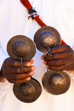 Moroccan musician with castanets  Musican playing castanet, Pigeons du Sable, spiritual music group from the Gnawa tribe (ancestors came as slaves to Morocco), Gnaoua Khamila
