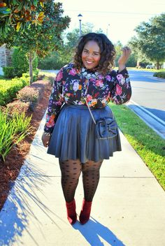 Floral shirt + leather skirt.
