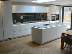 Renovate your kitchen with German Kitchen design styles Modern Kitchen Interiors, Modern Kitchen Cabinets, Wooden Kitchen, Modern Kitchen Design, Kitchen Layout, Interior Design Kitchen, Kitchen Island, Narrow Kitchen With Island, Kitchen Units