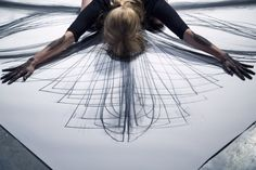 'Empty Gestures' live performance by artist Heather Hansen, who creates drawings with her own body.