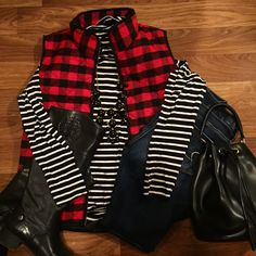 Pattern play outfit. Striped turtleneck with buffalo plaid vest and Hunter boots.